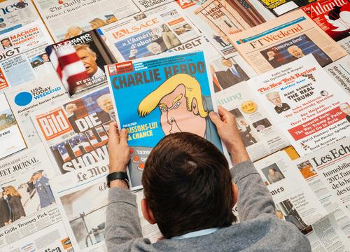 man reading charlie hebdo
